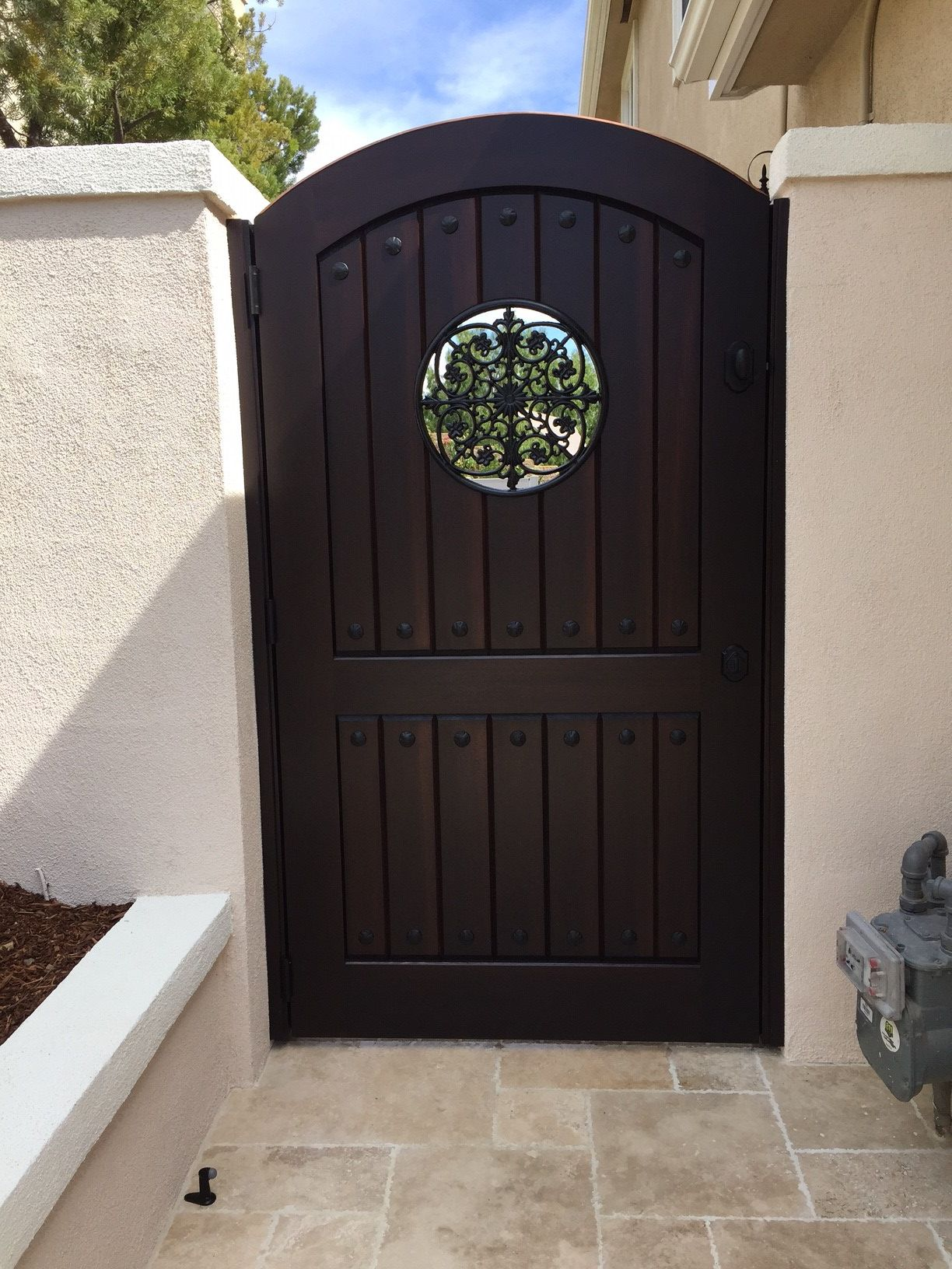 Custom Tuscan Style Wood Gate With Arched Top Circular Metal