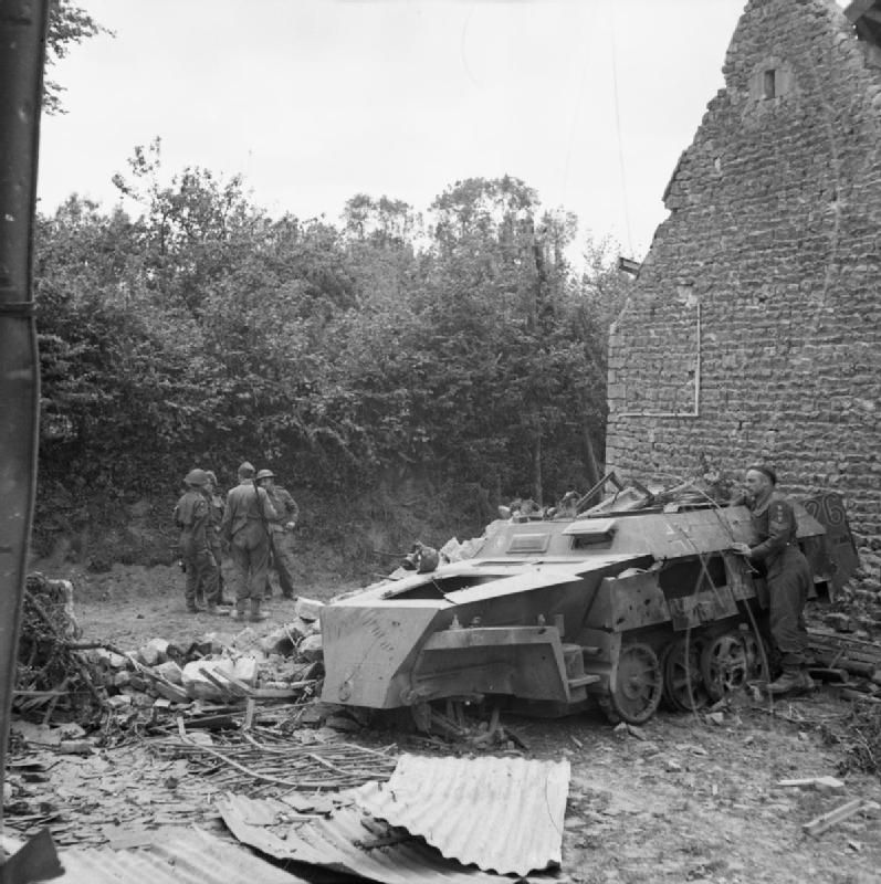A wrecked German SdKfz 250 half-track in the village of Christot-Tilly, 17 June 1944 / Un SdKfz 250 half-track Allemand détruit dans le village de Christot-Tilly