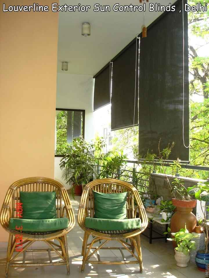 Balcony with bamboo chairs design by g p verma interior for Balcony interior design
