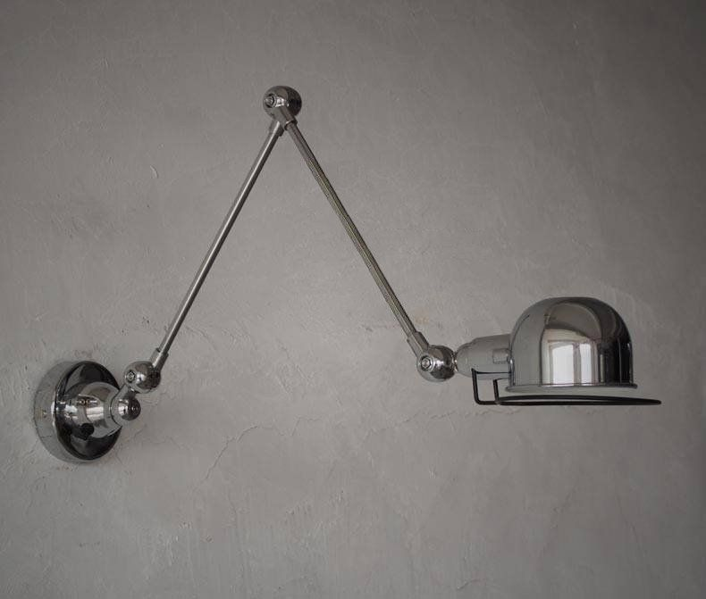 Fotis Long Arm Industrial Rustic Wall Light With Articulated Arm.  Interesting But It Might Be