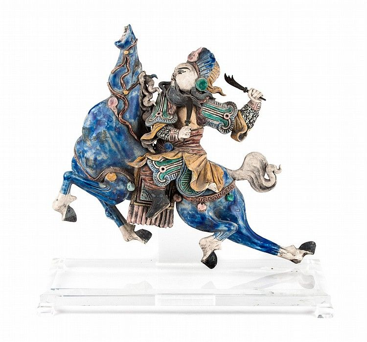 Chinese glazed terracotta figural roof tile - modeled as mountain warrior on horse with lucite display stand, 19 in. H. approx., 19 in. W. at base