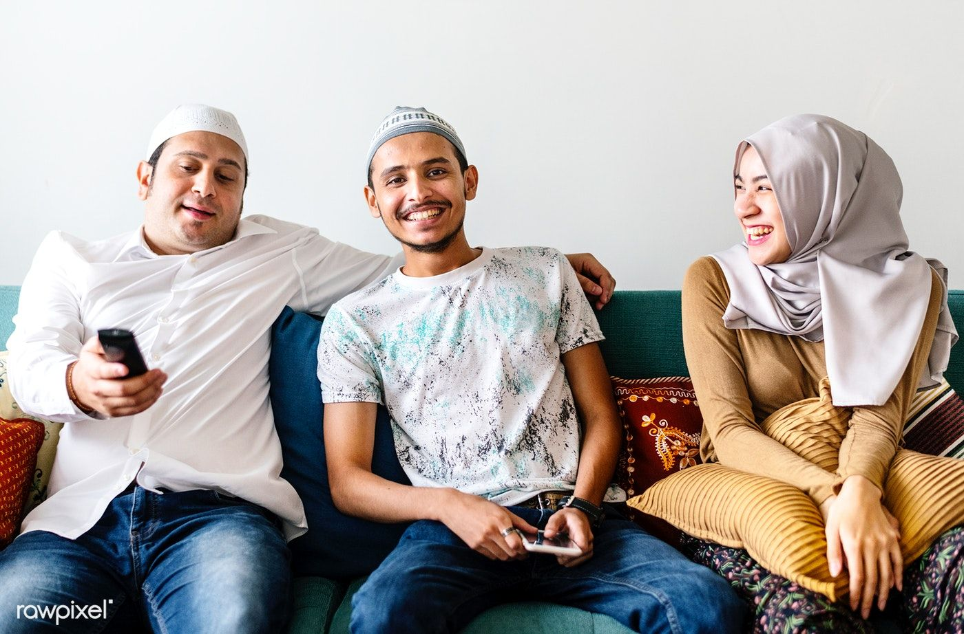 Download premium image of Muslim family watching tv at home