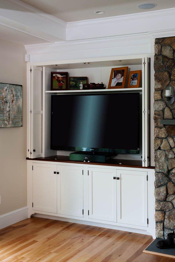 Folding Doors To Hide Tv Livingroom Layout Fireplace Built Ins