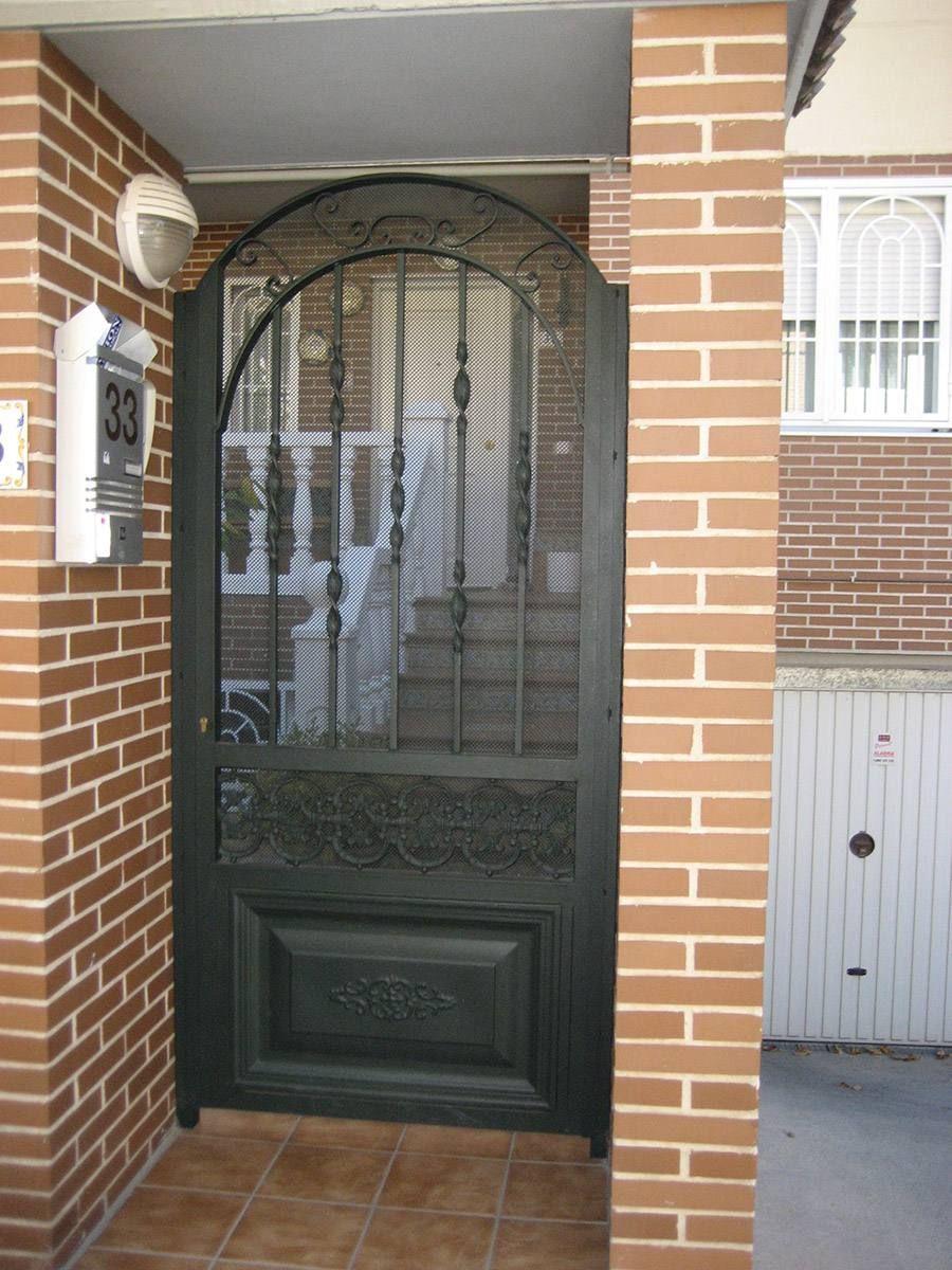 Puerta modelo hierro forjado ideas pinterest for Puertas metalicas para patio