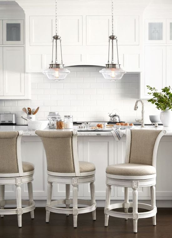 Traditional White Kitchen With Glass Pendant Lights Over Kitche