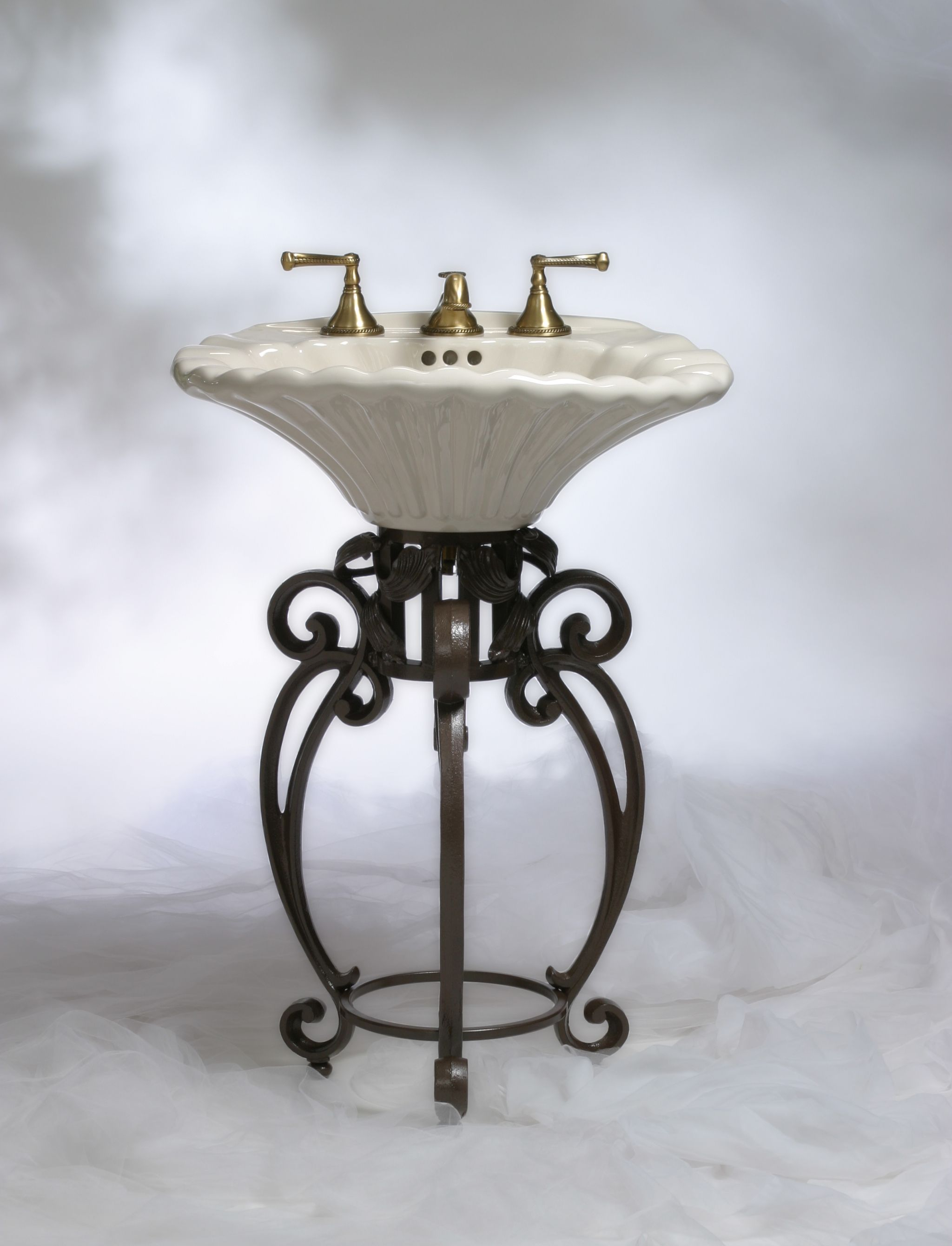 Small Pedestal Sink With Cast Iron Base And Shell Bowl An