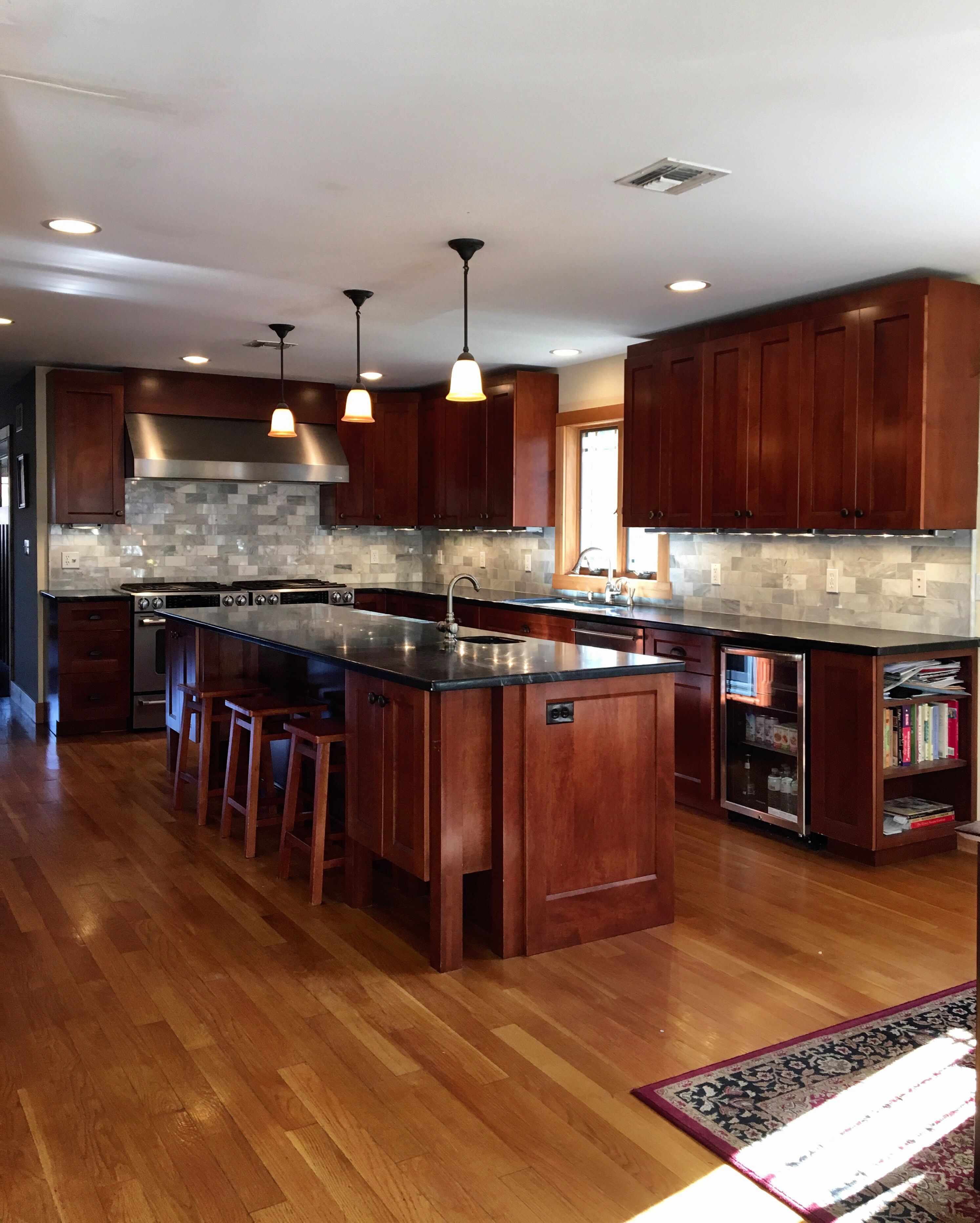 Soapstone counter top, marble backsplash, mahogany stained ... on Best Countertops For Maple Cabinets  id=74692