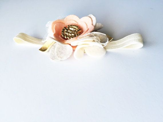 This soft and beautiful baby headband will add an ethereal feeling to any wedding, first birthday or photo shoot.  This stunning headband