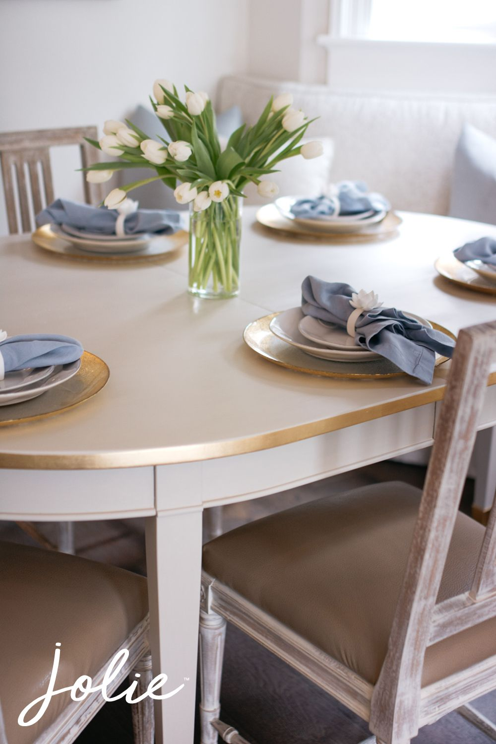 Transform your dining room table with Jolie Paint and Metal Leaf for a show-stopping tablescape when you entertain guests. Featured: Jolie Paint in Swedish Grey with Gold Metal Leaf details.   #joliepaint #joliehome #joliebyme #makelifebeautiful #jolie #mattepaint #mattpaint #furniturepaint #furnituremakeover #furniturerehab #furnitureupdate #creativehappylife #interiordesigninspo #inspo #colorinspiration #paintedfurniture #beforeandafter #furniturepaint #paintedtable #diyfurniture #tablescape