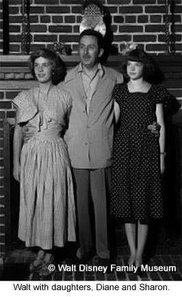 Walt Disney n his daughters