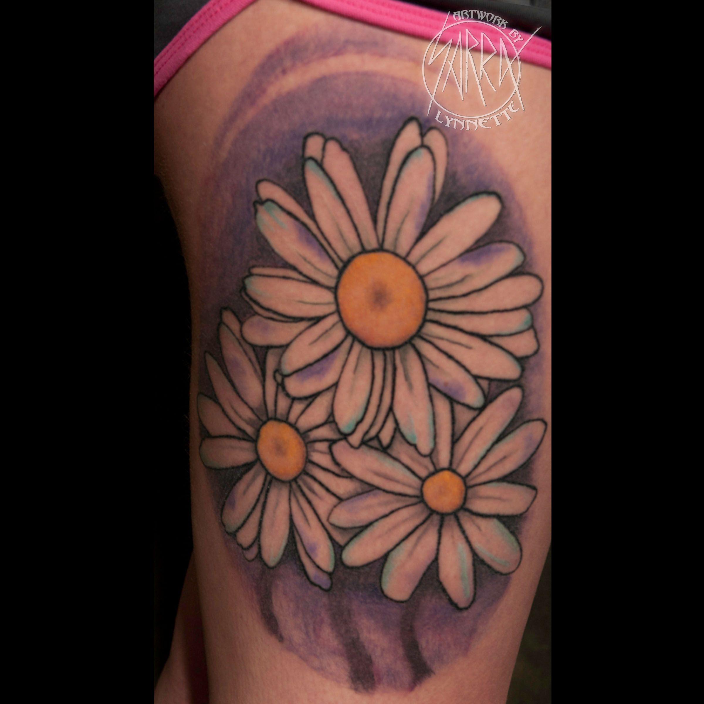 Daisy flowers tattoo by Sarra Tattoos Flower