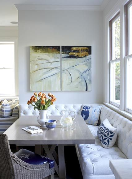 Simple and white with accents of blue, this banquette lets the sunshine flow into the kitchen as breakfast and lunch are served in the tufted white faux ostrich benches. A brave mom to boot!