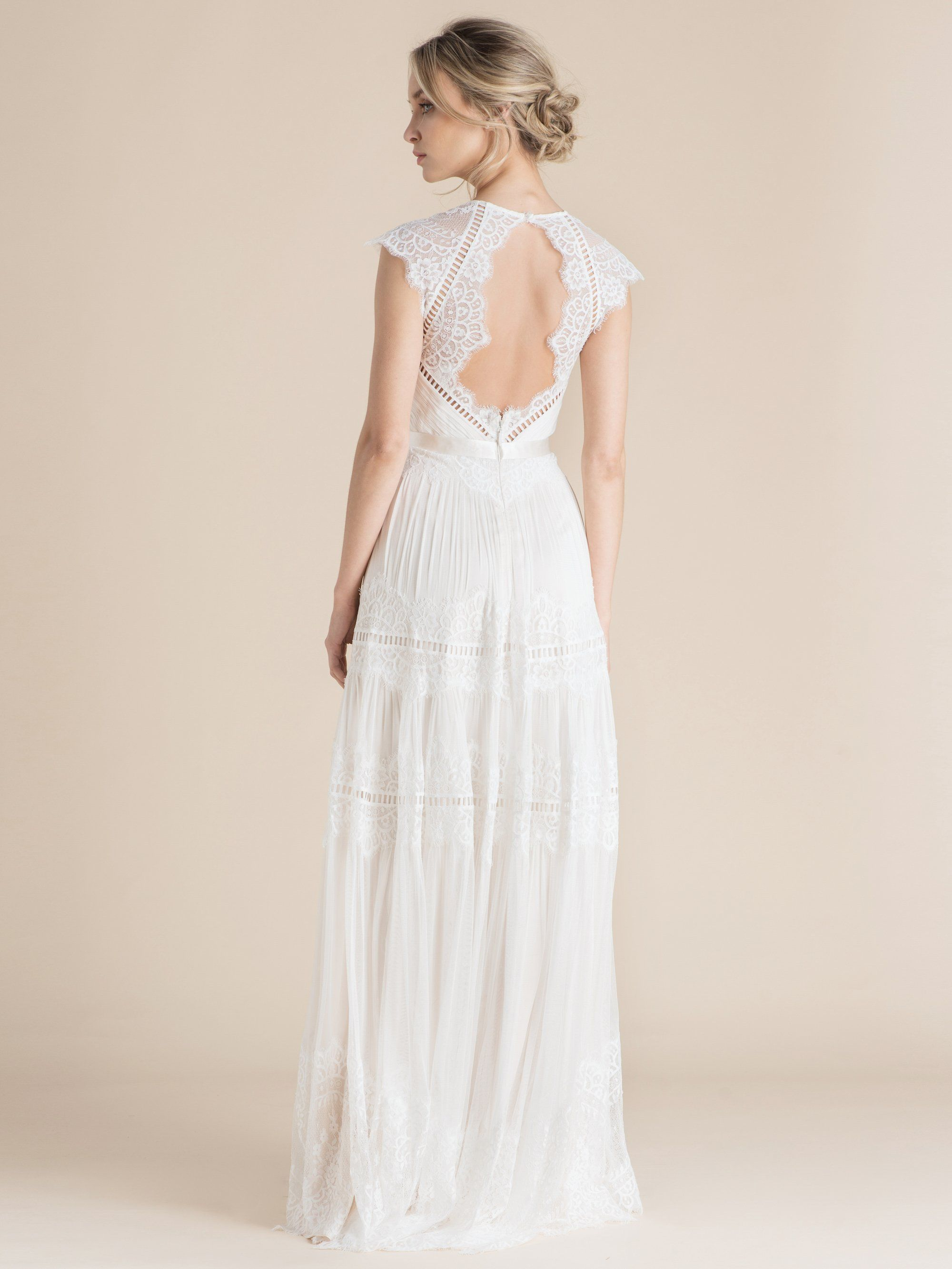 Boho wedding dress emphasised by vintagestyle graphic