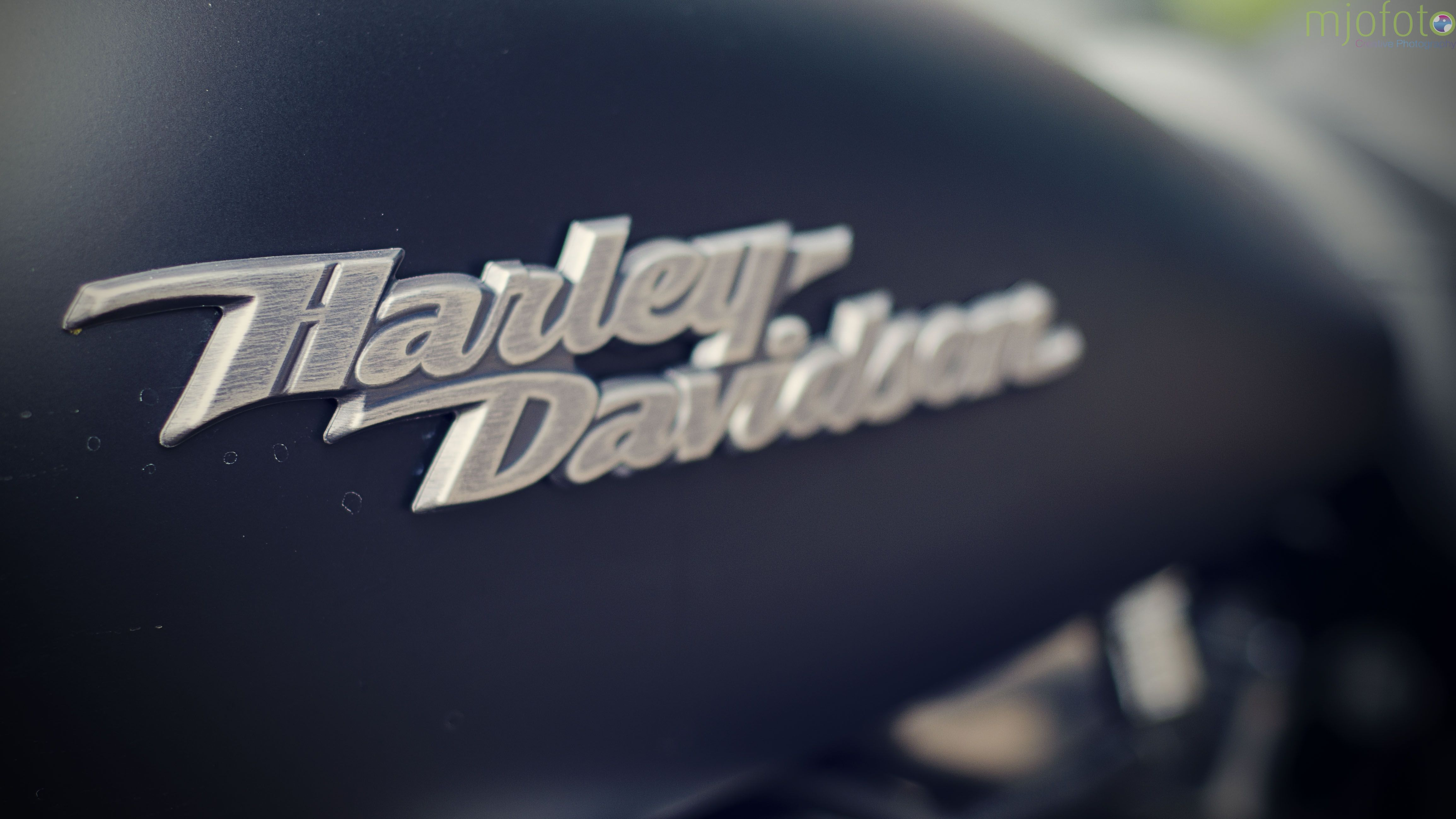 Matt Black Tank on a Harley