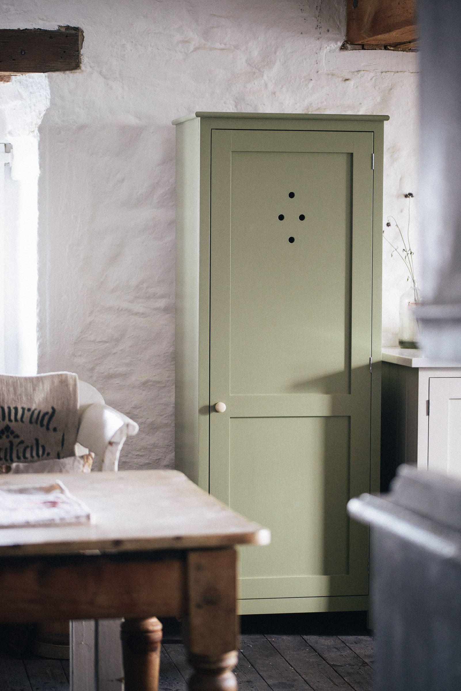 A little green Shaker pantry cupboard by deVOL Kitchen