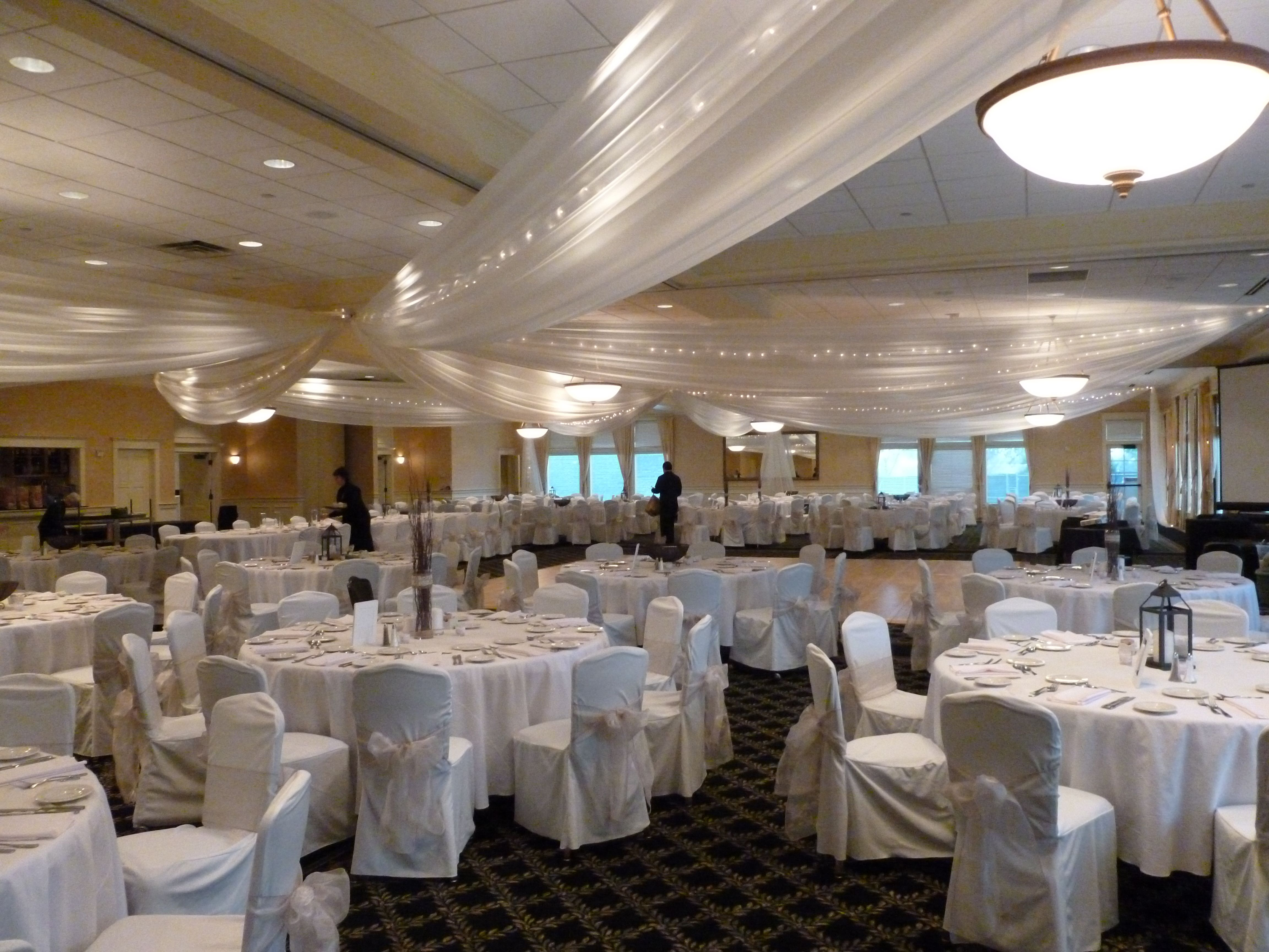 Ivory ceiling draping ivory chair covers with champagne organza ivory ceiling draping ivory chair covers with champagne organza sashes low bow at junglespirit Image collections