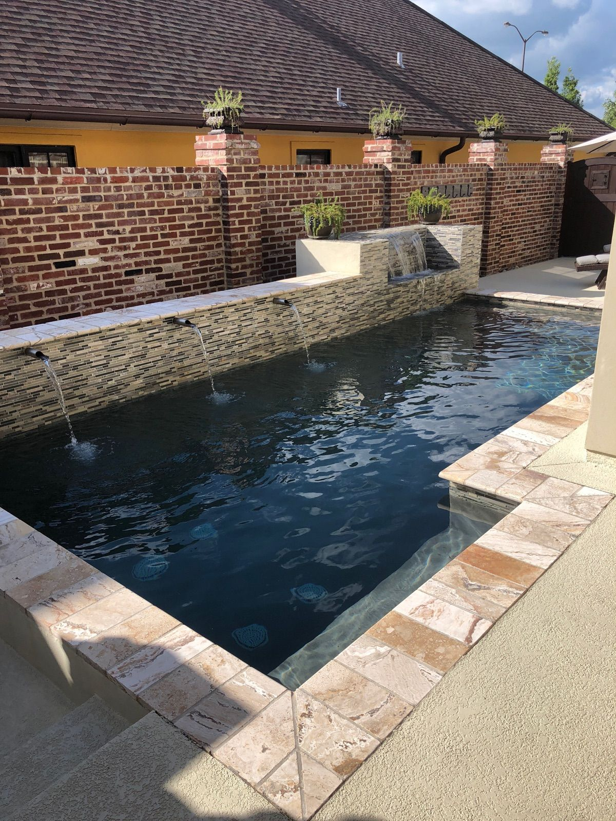 Beautiful Pool Complete With Waterfall And Travertine Coping Call Today To Get An Estimate Backyard Vacation Swimming Pool House Swimming Pools