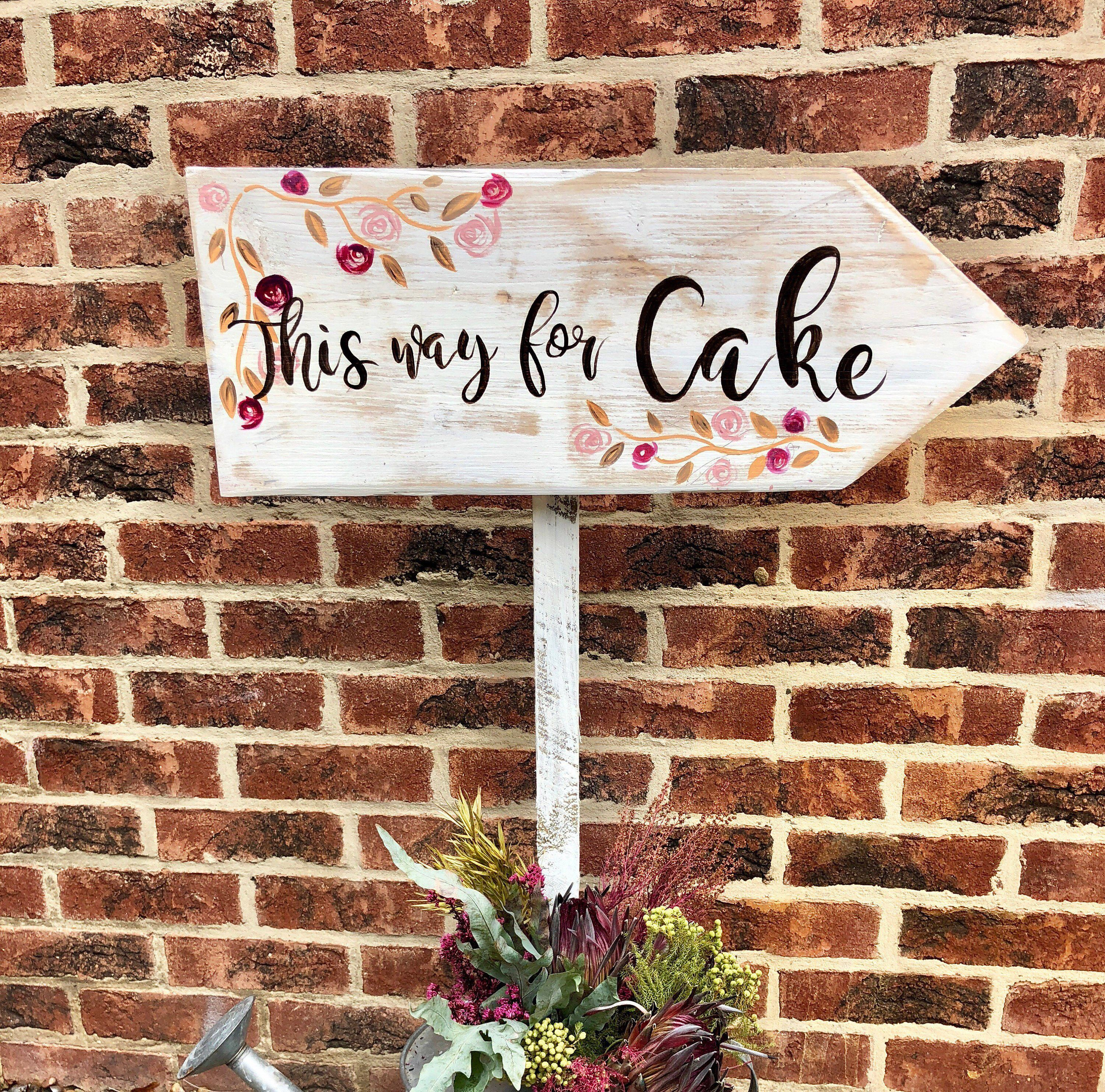 Wedding Arrow Sign With Flower Decoration For A Country