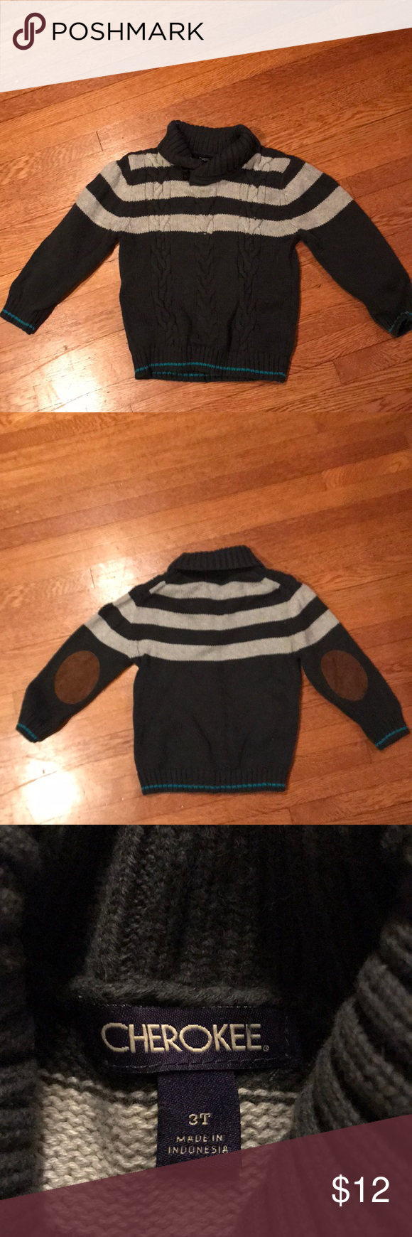 Dark gray and light gray stripe roll neck pullover Cherokee dark gray pullover sweater. Has light gray stripes and roll neck with two buttons. Has brown suede elbow patches and a stripe of teal at wrists. Perfect condition. Cherokee Shirts & Tops Sweaters