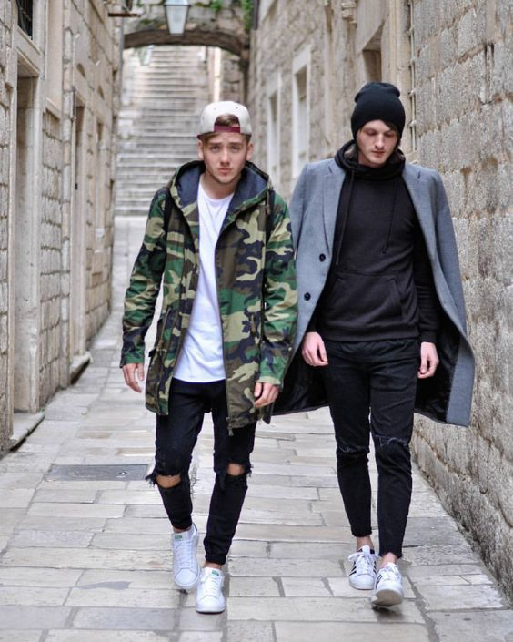 A green camo parka and black destroyed jeans are a great outfit formula to  have in your arsenal. Round off this look with white low top sneakers. c2fd6820390
