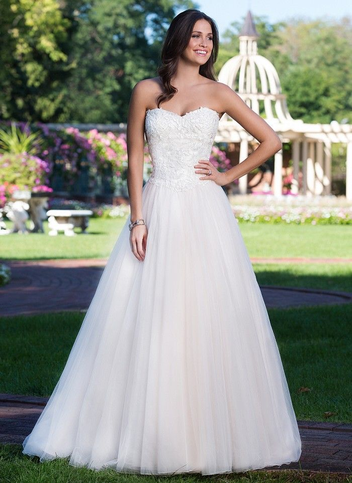This sweetheart ball gown features a corset back, basque waistline ...