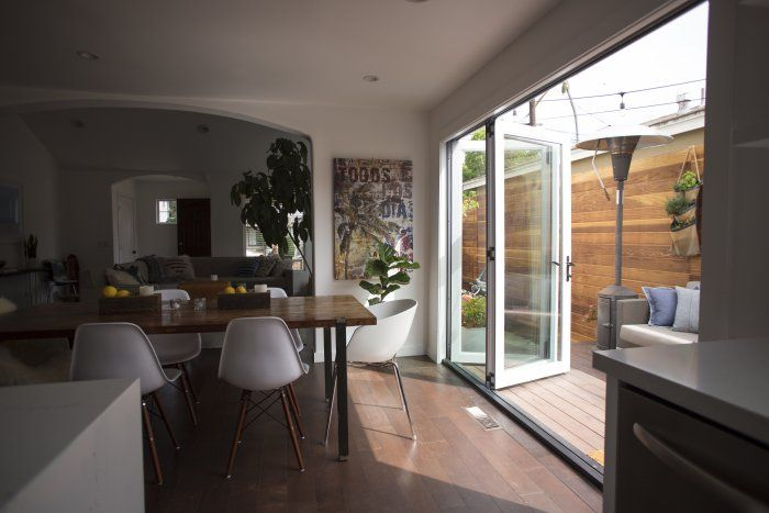 sliding doors open up dining room to outdoors