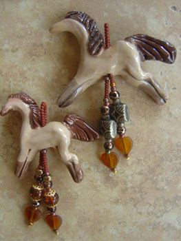 Handcrafted horse pendants.  Made in Montana.