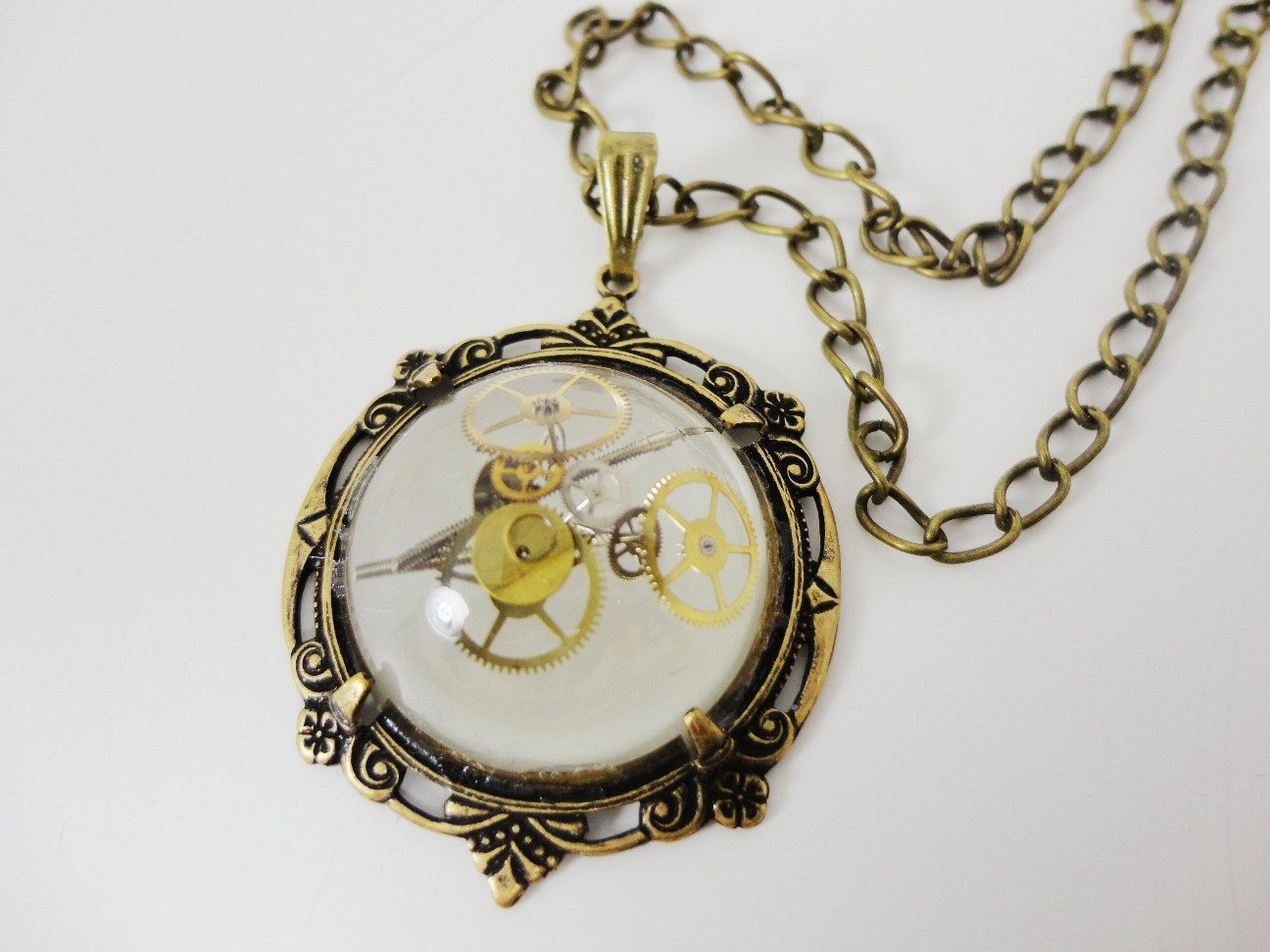 Steampunk Necklace Frozen Time Orb with gears in Victorian brass by Dr Brassy Steamington. $25.00, via Etsy.  Frozen in time!