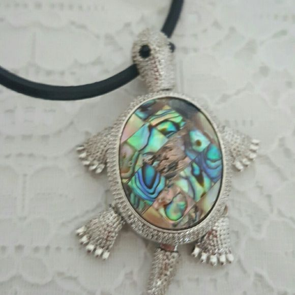 Turtle Shell Movable Legs Leather Necklace Mother of pearl? Anyone can tell me what this material is called? Little legs move.  No trades, but feel free to make reasonable offers. Make sure to check out other items as I bundle! ?? Jewelry Necklaces