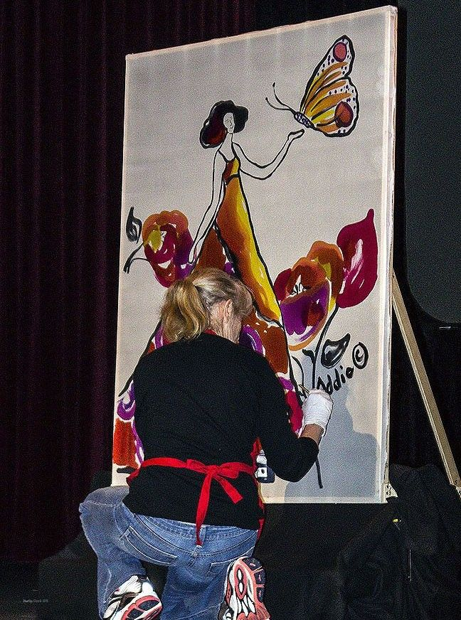 "Festival of Silk Painters Raises Hail in Santa Fe. ""Changing Elements"" Fashion Show opened with performance of ""The Dancing Brush"" by Addie Chernus at Greer Garson Theater on campus of Santa Fe University of Art and Design. Photo by Muffy Clark Gill."