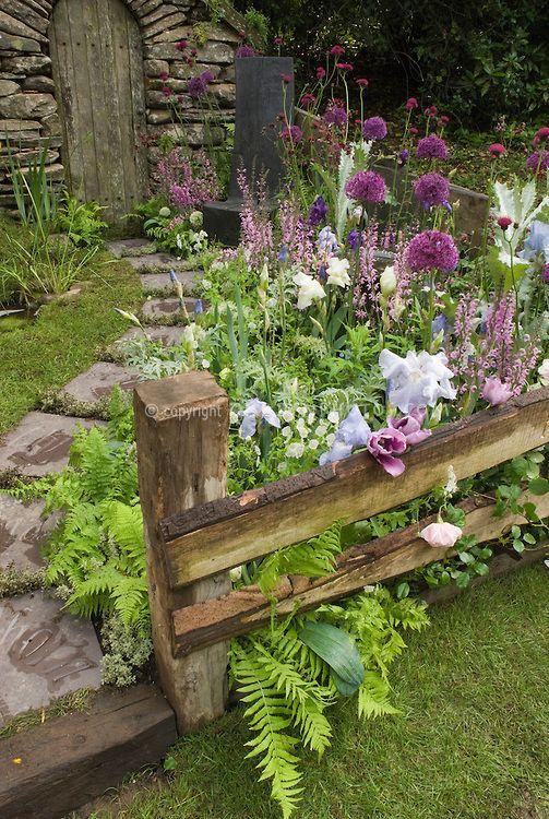 Secret Garden: Stone Garden Walk Path With Lush Flower Garden And Stone