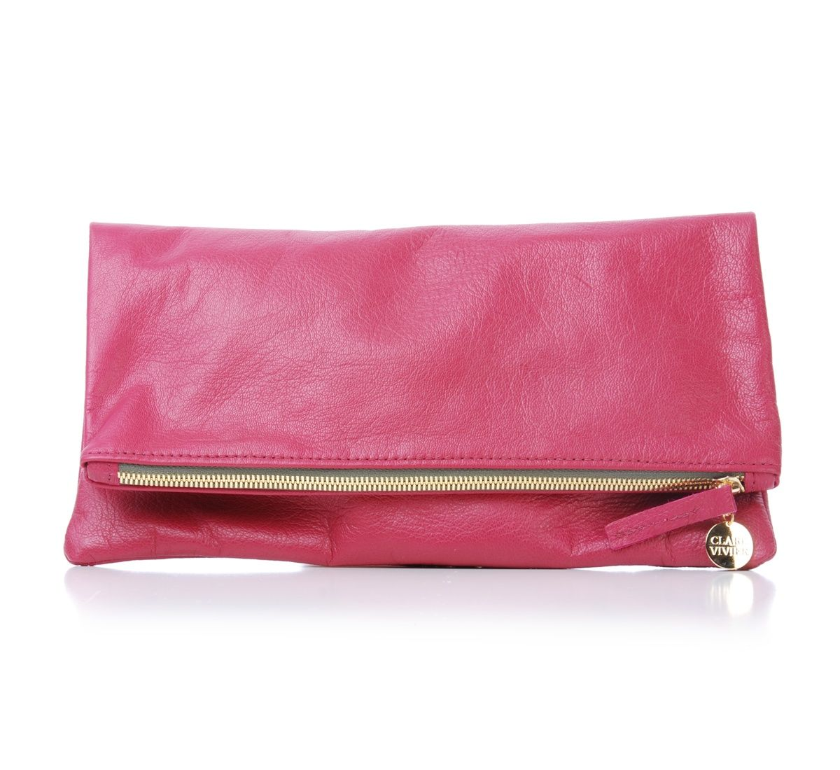 The perfect Spring accent piece -  The foldover clutch by Los Angeles designer Clare Vivier.  Known for her chic, sporty designs and eco friendly materials, this dark pink leather clutch is a versatil...