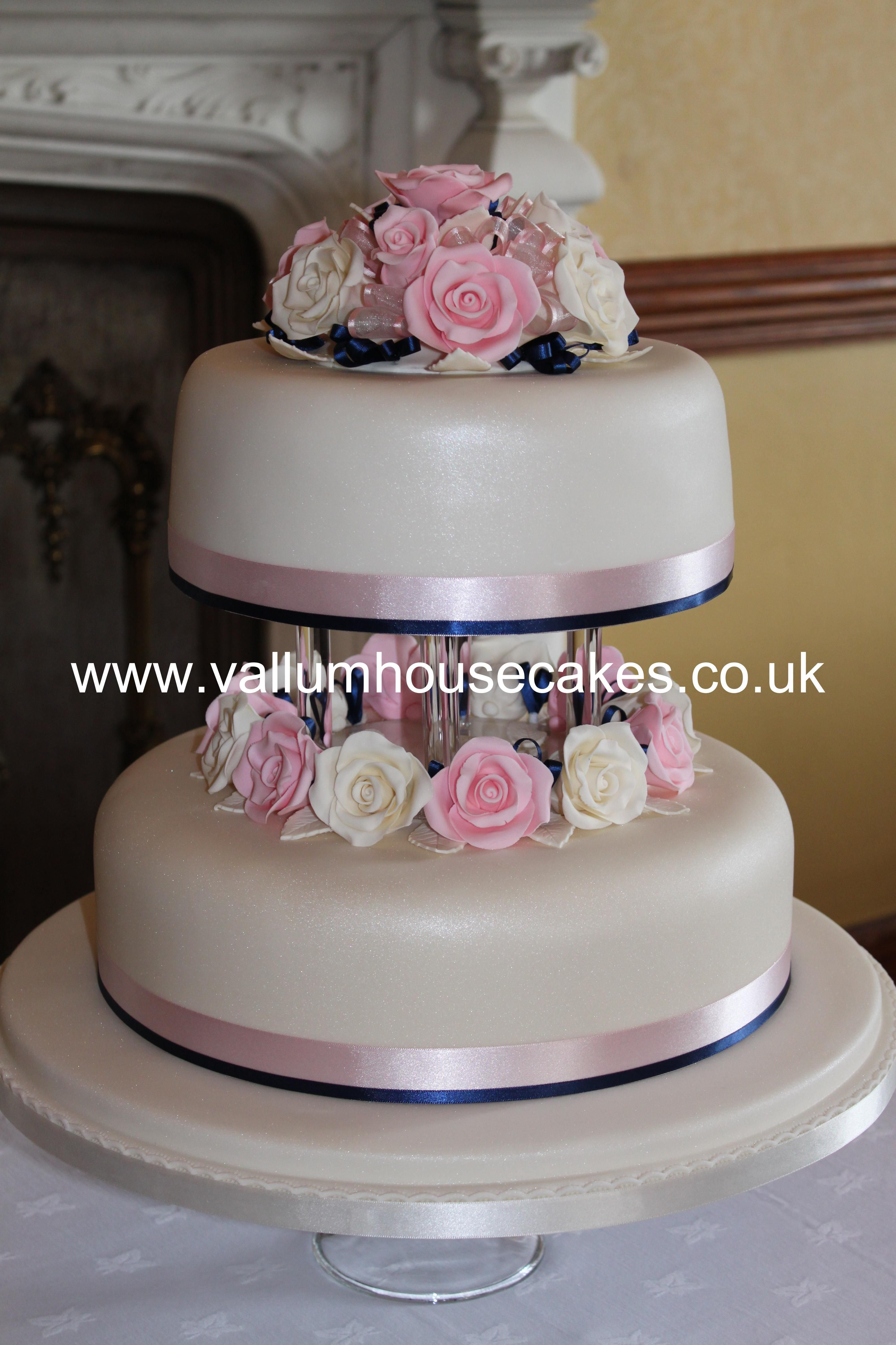 Lovely, 2 tier ivory wedding cake with centre separator, pink and ...