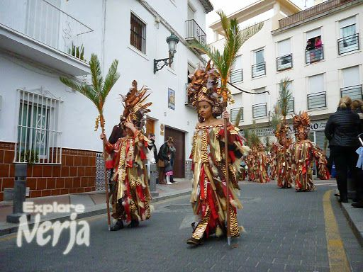 The Saturday procession passes through the streets of Nerja.