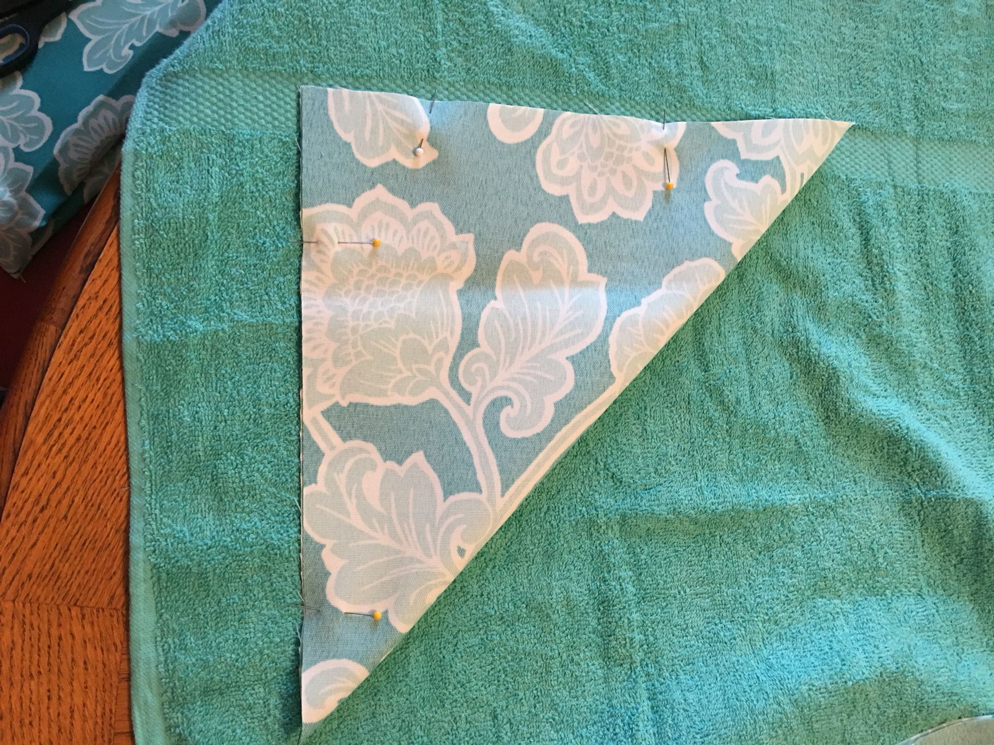 6. With right sides together fold into a triangle. Pin and see together leaving an opening to turn right side out.
