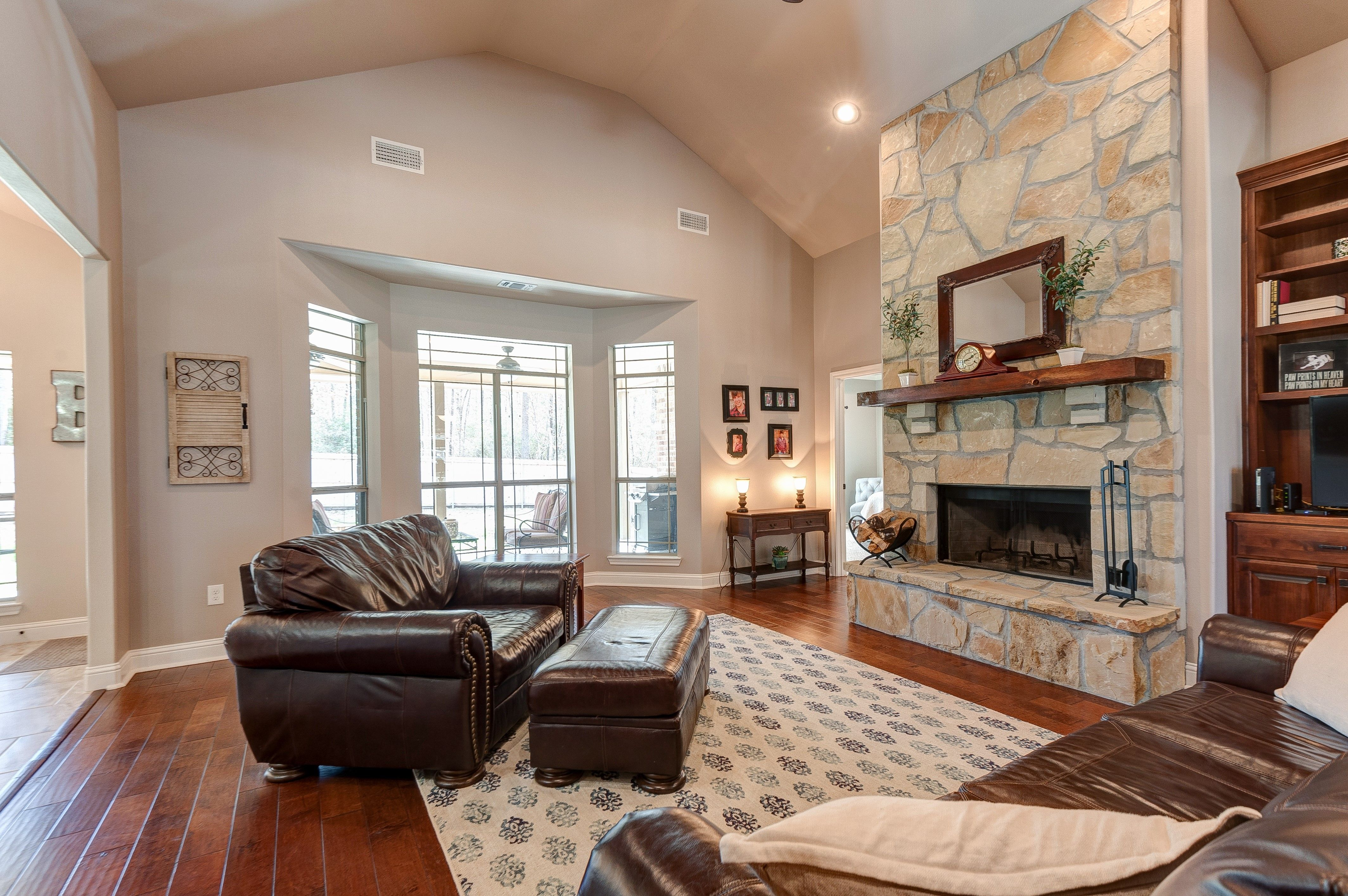 Soaring Ceilings In This Open Family Room With Stone Fireplace