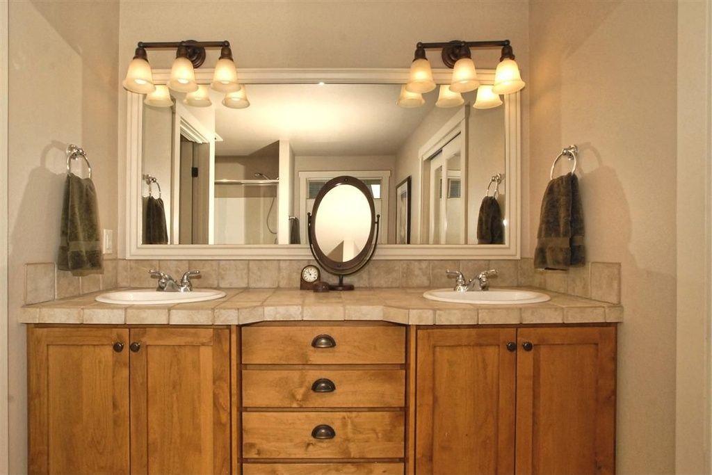 Traditional Master Bathroom with Vanity mirror, Framed mirror ...