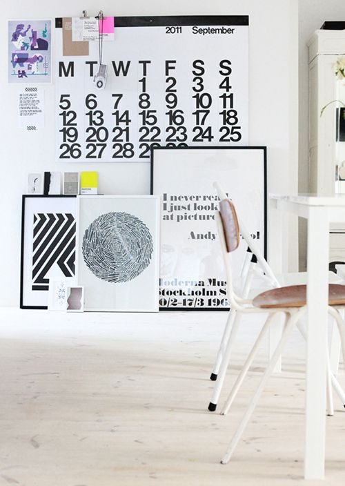 Stacked graphic prints + Stendig Calendar make for beautiful details