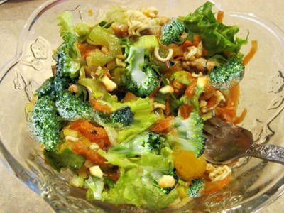 A great summer salad with an array of colors. Made of salad greens, garden vegetables, broccoli,  Mandarin oranges, pineapple, sugary cashews and ramen noodles with an oriental flavored salad dressing.