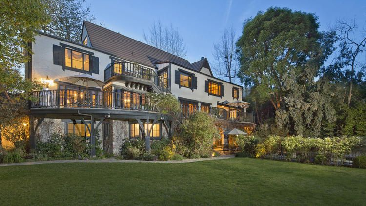 Home of the Day Tudor style on the Westside Tudor style
