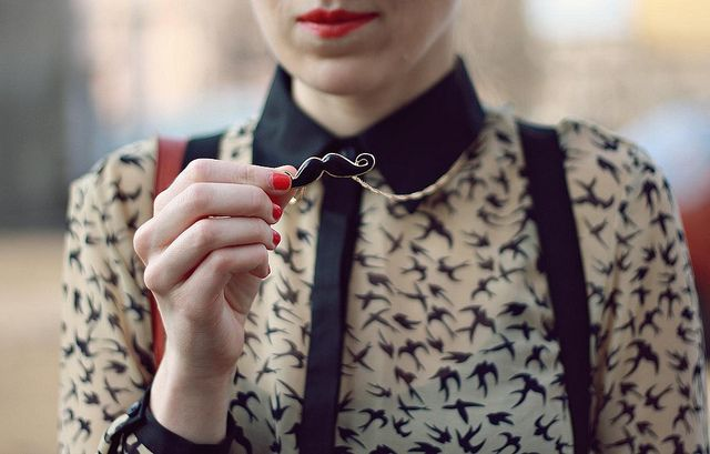 bird blouse + mustache necklace.