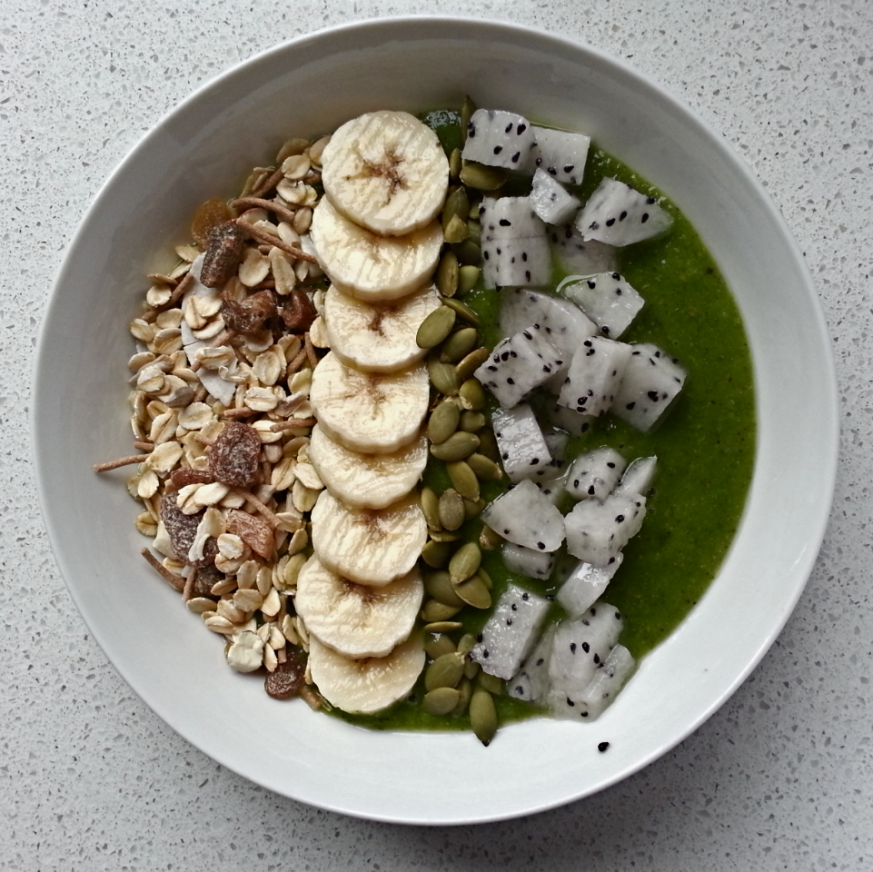 This mornings smoothie bowl. Smoothie: 2 kiwi fruit, 1 pear, 1 cup baby spinach, 1 cup kale, 1/2 a cup cold water and ice. Garnish: Apricot almond and date muesli, banana, kiwi fruit, pumpkin seeds and dragon fruit <3 #healthyeating #healthyliving #smoothiebowl #fruit