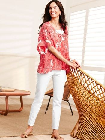 Perfect summer look: Talbot's papaya poncho paired with white jeans.