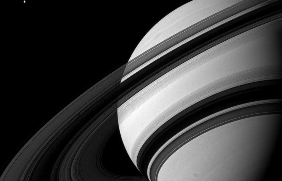 This image depicts the unilluminated side of Saturn's rings and was taken in green light with NASA's Cassini spacecraft wide-angle camera on Aug. 19, 2012. The view was captured at a distance of approximately 1.5 million miles from Saturn.