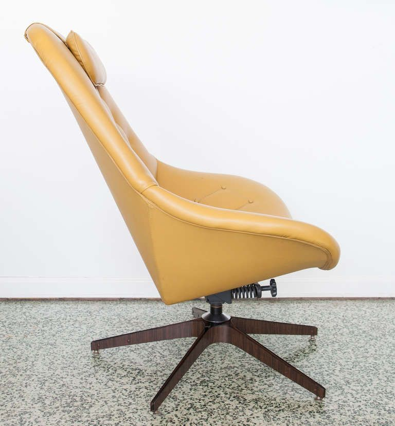 Swivel Lounge Chair + Ottoman by George Mulhauser for Plycraft | Similar to mine except for  base and back.