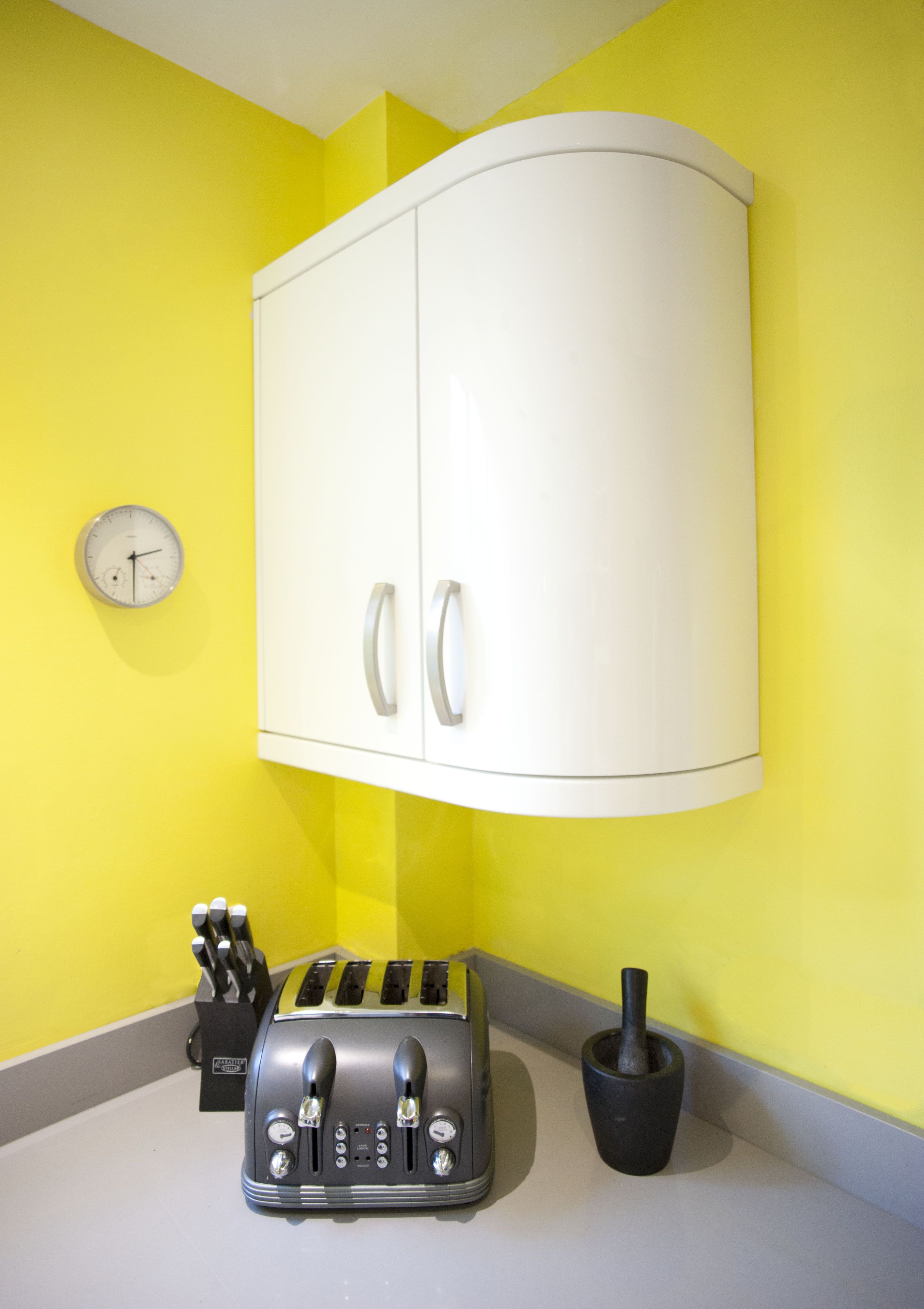 Yellow And White Kitchen A Beautiful White Gloss Curved Kitchen Which Has Been Brightened