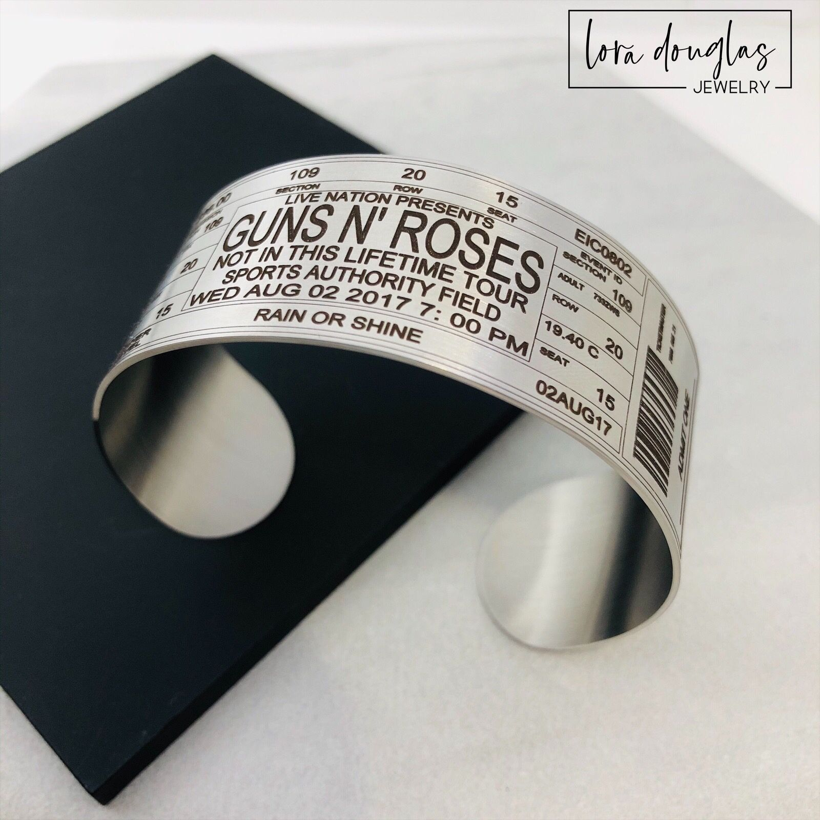 Guns N' Roses • Not In This Lifetime Tour • Sports Authority Field⁠ • We can permanently laser engrave any ticket on a #bracelet #bookmark or #keychain • Link in Bio⁠ .⁠ .⁠ #concert #livemusic #music #imisshairbands #laserengraving #favoritesong #jewelryisfun #myloradouglasjewelry #rocknroll #engraving #axlrose #headbangersball #mtv #the80s #musicphotography #concertphotography #gunsnroses #gnr #slash #notinthislifetime #gnfnr #amplified #metallica #aerosmith #defleppard #vanhalen