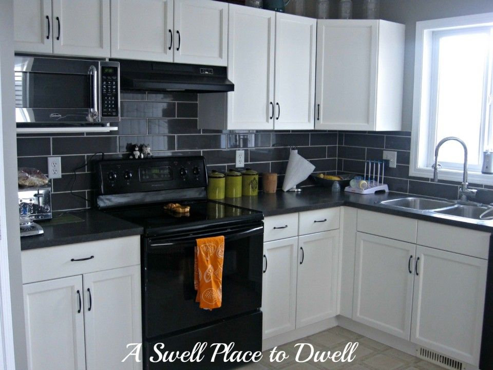 Cool Small Kitchen Interior In Black And White Palette With White L Shaped Cabin Black Appliances Kitchen Interior Kitchen Small White Kitchen Black Appliances