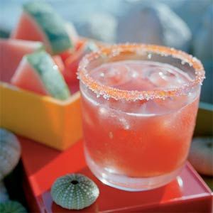watermelon margarita:  1 cup sugar + 1 cup water + 3.5 cups seeded, cubed watermelon + 3/4 cup tequila + 1/2 cup fresh lime juice and crushed ice