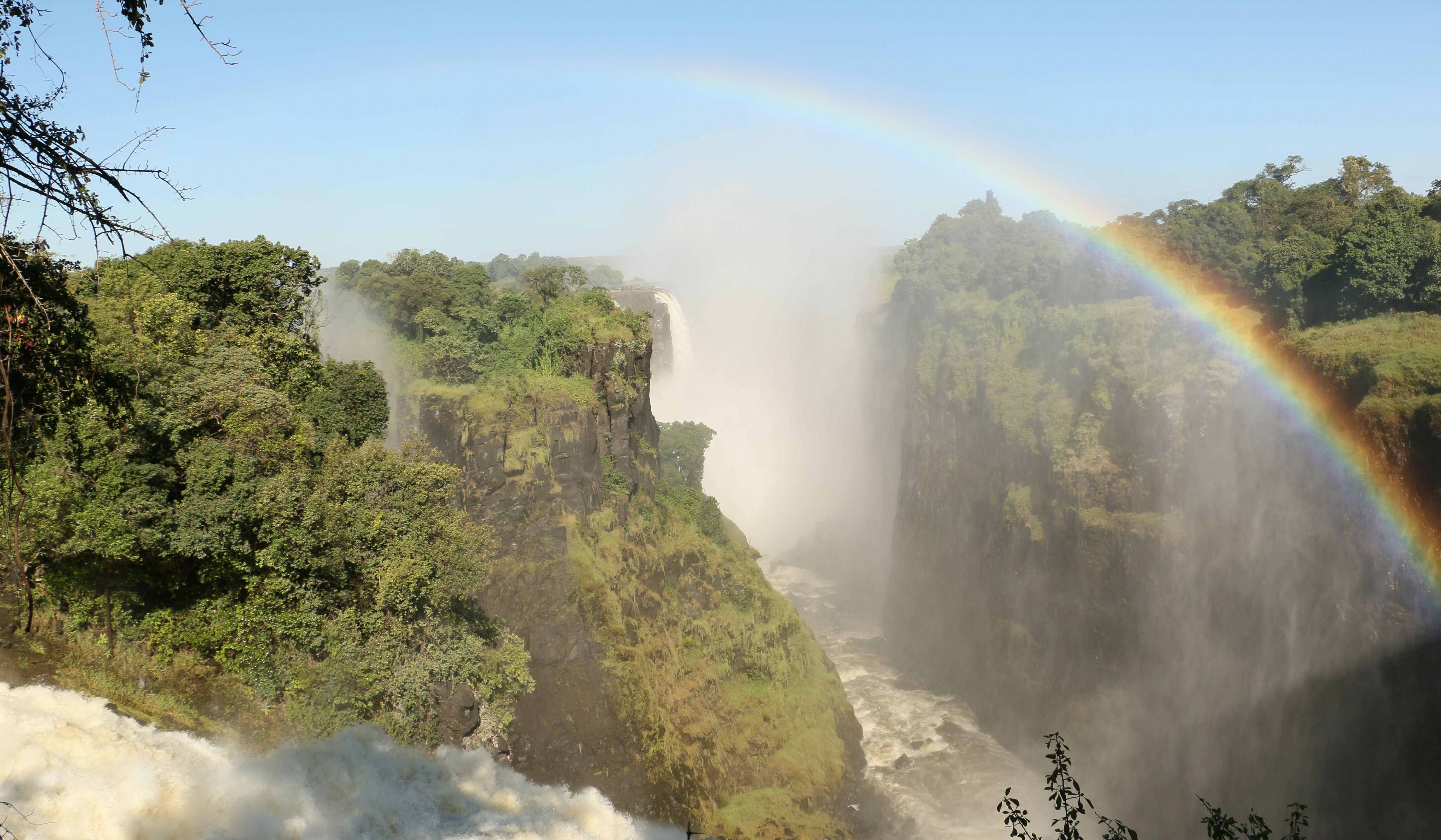 Enjoy a gentle stroll around the iconic Victoria Falls whilst being drenched by it's spray.